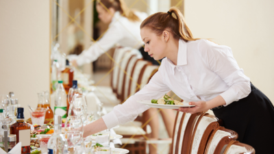 Caterer Setting the Table
