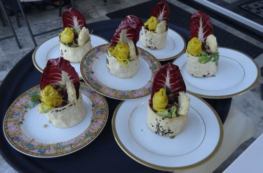 Salad plates on oval trays.